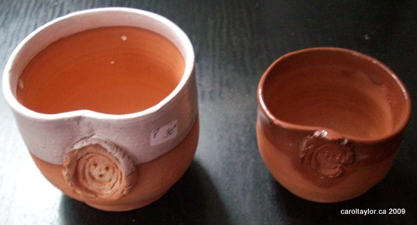 Wine cups with applied embossed decoration – showing interiors
