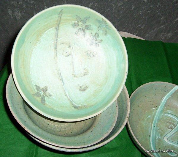 An assortment of green glazed bowls